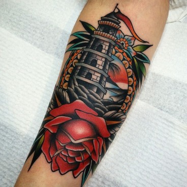 flower-and-lighthouse-in-frame-nautical-tattoo-by-kirk-jones